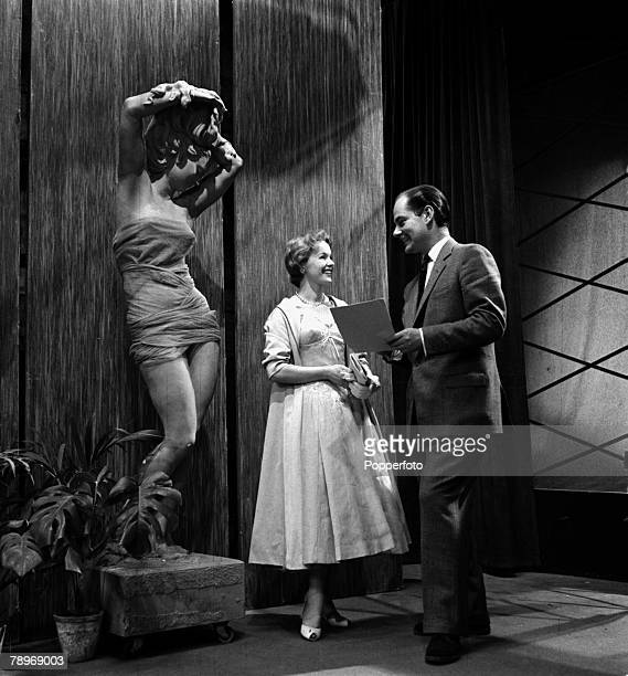 England On the set of the television programme Picture Parade at Lime Grove presenter Peter Haigh is pictured with actress Peggy Cummins