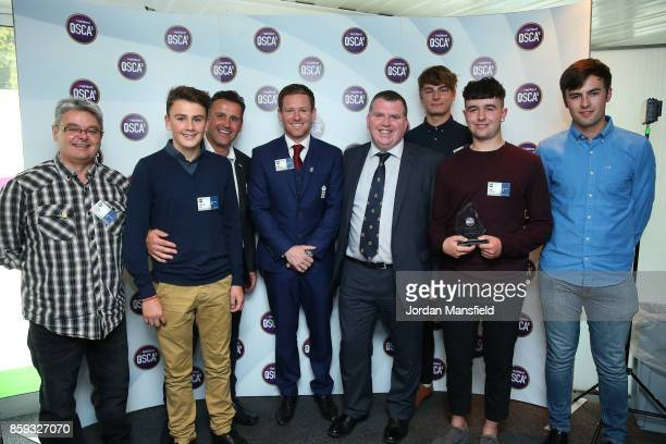 England OneDay Captain Eoin Morgan and NatWest Private Banking Manager John Kennelly present the NatWest U19 Club T20 Club of the Year to Ilminster...