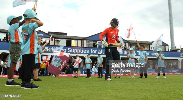 England openers Amy Jones and Danielle Wyatt walk onto the pitch during the 2nd Vitality Women's IT20 match between England and the West Indies at...