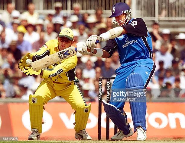 England opening batsman Alec Stewart hits out as Australian wicketkeeper Adam Gilchrist looks on in their match at the Oval in London 21 June 2001...