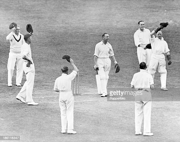 England opening batsman Jack Hobbs receives three cheers from the Australian team at the start of England's 2nd innings during the 5th Test match at...