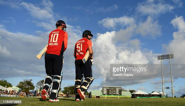 England opening batsmen Alex Hales and Jonathan Bairstow walk out to bat during the 3rd Twenty20 International match between England and West Indies...