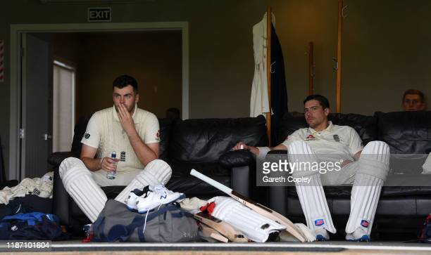 England opening batsmen Dom Sibley and Rory Burns wait for the rain to stop during the tour match between New Zealand XI and England at Cobham Oval...