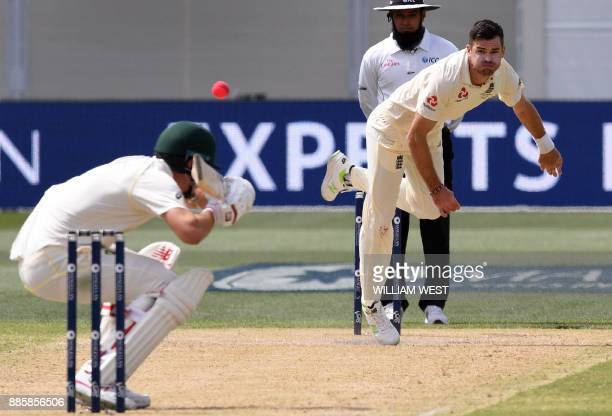 England paceman James Anderson sends down a bouncer to Australian batsman Pat Cummins on the way to capturing five wickets on the fourth day of the...