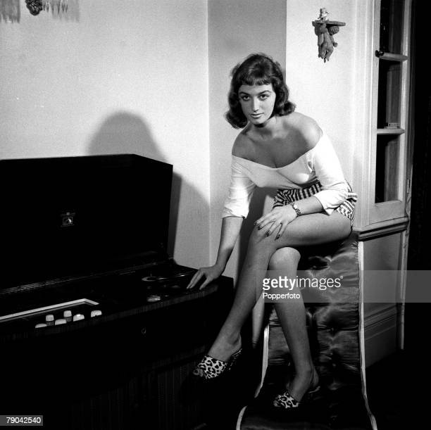 1954 British bestselling novelist Jackie Collins pictured posing at her home Jackie Collins found fame writing raunchy romance books many converted...