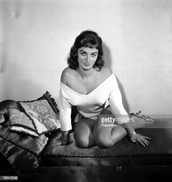 1955 British bestselling novelist Jackie Collins pictured posing at her home Jackie Collins found fame writing raunchy romance books many converted...