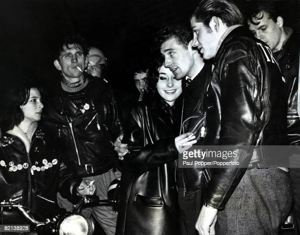 23rd May 1964 A group of Rockers teenage boys and girls get together Rockers were motor cycle enthusiasts wearing leather and with no real regard for...