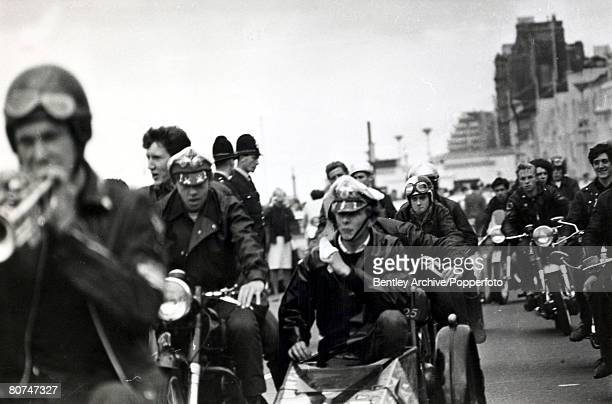 3rd August 1964 A group of Rockers riding into Hastings Sussex with police watching for any trouble Rockers were motor cycle enthusiasts wearing...