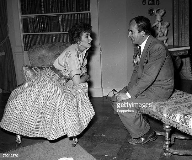 England Pictured on the set of the film 'The Constant Husband' are actress Kay Kendall and producer Frank Launder