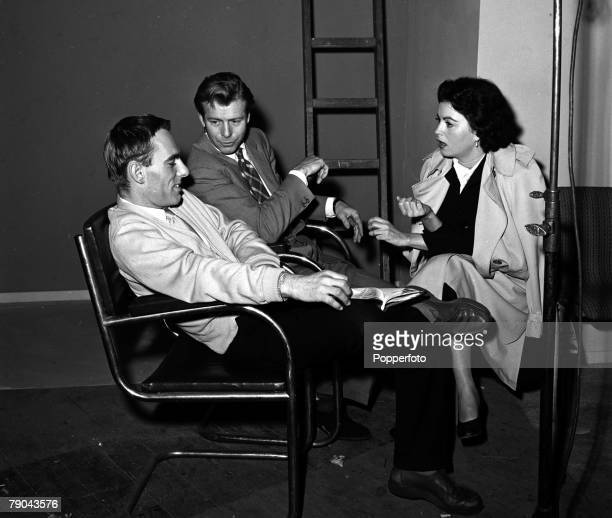 England Pictured on the set of the film Timeslip are LR Director Ken Hughes Gene Nelson and Faith Domergue