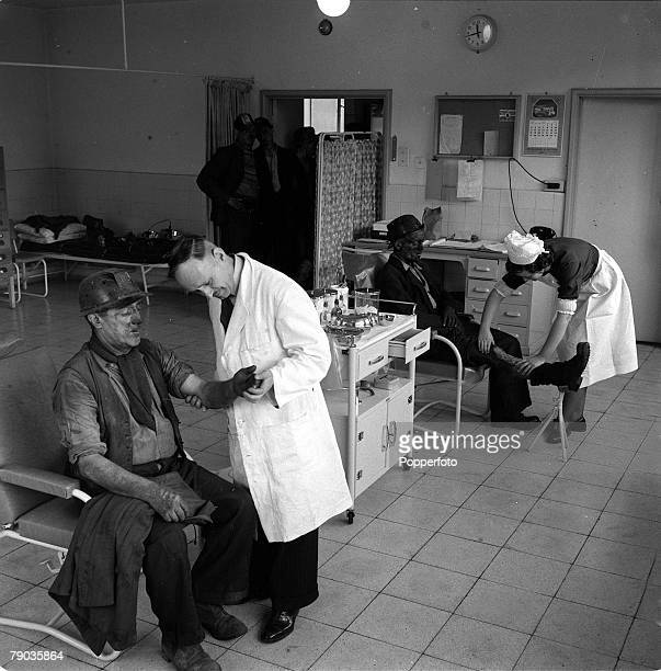 England Pit Nurses Two miners receive medical assistance from a doctor and nurse at a colliery surgery