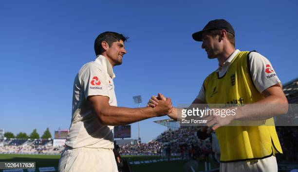 England player Alastair Cook is congratulated by Chris Woakes after the 4th Specsavers Test Match between England and India at The Ageas Bowl on...