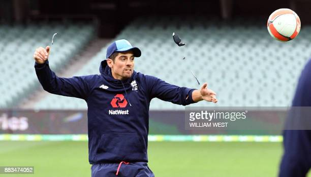 England player Alastair Cook smashes his glasses as he heads the football during training at the Adelaide Oval ahead of the second Ashes cricket Test...