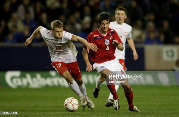 England player Andrew Surman bursts past the challenge of Adam Danch during the Under21 International Friendly between England and Poland at Molineux...