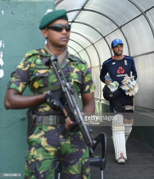 England player Ben Foakes makes his way past the armed security guard to the field during England Nets ahead of the 3rd Test Match at the Sinhalese...