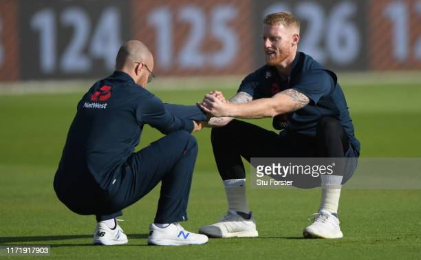 England player Ben Stokes and Jack Leach stretch during England nets ahead of the 4th Test match at Emirates Old Trafford on September 03, 2019 in...