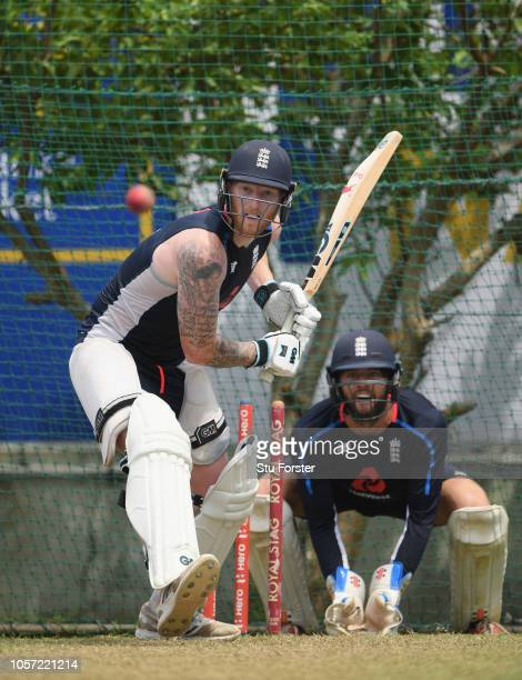 England player Ben Stokes bats as wicketkeeper Ben Foakes looks on during England Nets ahead of the First Test Match at Galle International Stadium...
