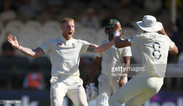 England player Ben Stokes celebrates the wicket of Anrich Nortje with Stuart Broad during Day Five of the Second Test between South Africa and...