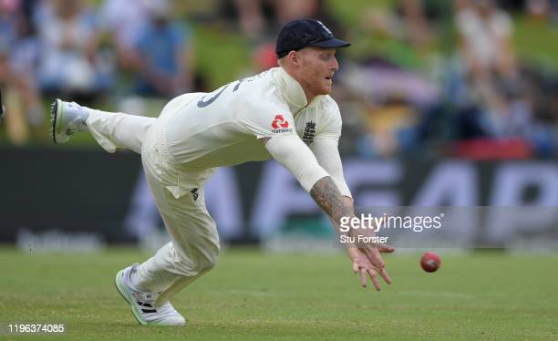 England player Ben Stokes dives for a ball hit through the slips during Day Three of the First Test match between England and South Africa at...