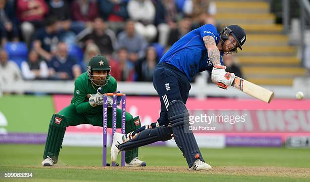 England player Ben Stokes hits a six watched by wicketkeeper Sarfraz Ahmed during the 5th One Day International between England and Pakistan at...