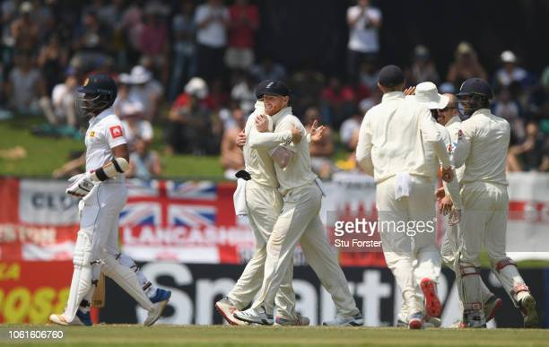 England player Ben Stokes is congratulated after taking a catch off Jack Leach to dismiss Mendis during Day Two of the Second Test match between Sri...