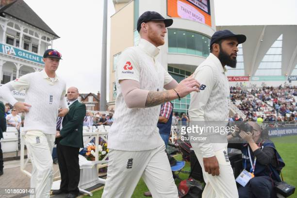 England player Ben Stokes pictured entering the field with Adil Rashid and Keaton Jennings before day one of the 3rd Specsavers Test Match between...