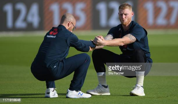 England player Ben Stokes with Jack Leach stretch during England nets ahead of the 4th Test match at Emirates Old Trafford on September 03, 2019 in...