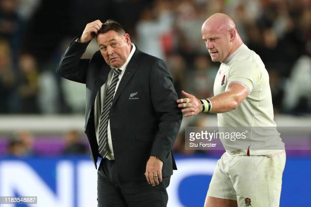 England player Dan Cole consoles New Zealand coach Steve Hansen after the Rugby World Cup 2019 Semi-Final match between England and New Zealand at...
