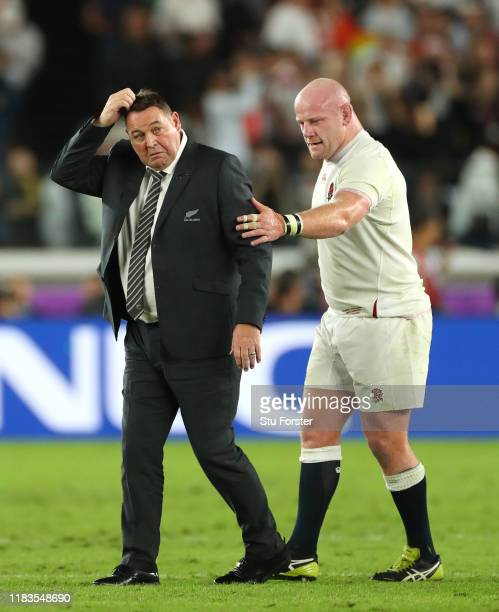 England player Dan Cole consoles New Zealand coach Steve Hansen after the Rugby World Cup 2019 SemiFinal match between England and New Zealand at...