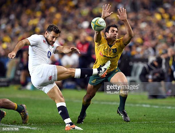 England player Danny Care gets his kick away as his Australian counterpart Nick Phipps attempts to charge him down during the third and final rugby...