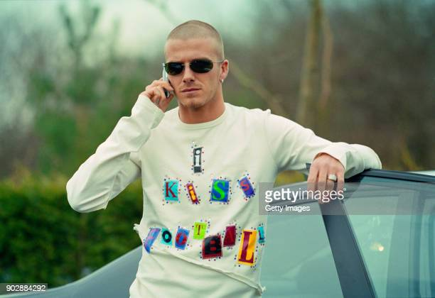 England player David Beckham on his mobile phone at the launch of the Adidas 'I kiss Football' campaign at adidas HQ in Stockport on March 15 2001