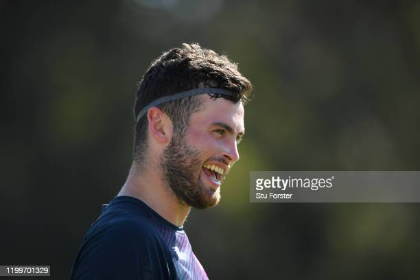 England player Dom Sibley smiles as he tries Ollie Pope's head band for size during England nets ahead of the 3rd Test Match against South Africa at...