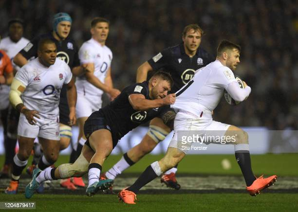England player Elliot Daly makes a break during the 2020 Guinness Six Nations match between Scotland and England at Murrayfield on February 08 2020...