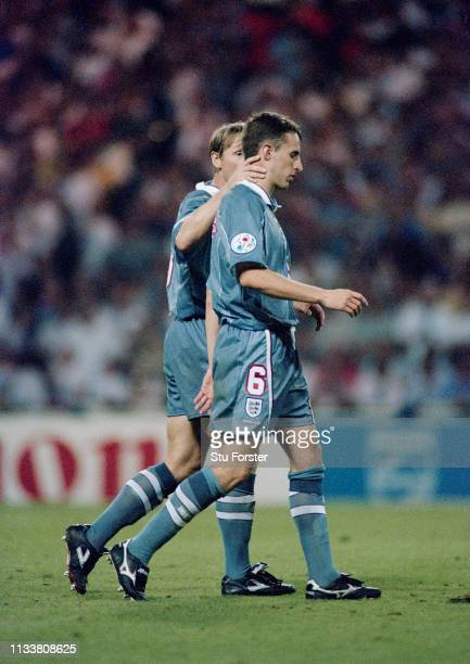 England player Gareth Southgate is consoled by Stuart Pearce after having his penalty saved by goalkeeper Andreas Kopke during the 1996 UEFA European...