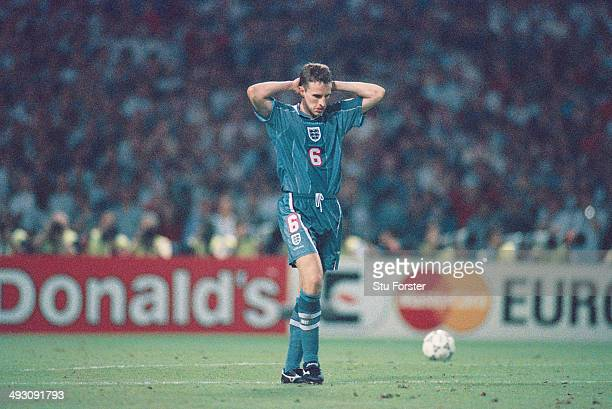 England player Gareth Southgate reacts after missing his penalty during the penalty shoot out during the European Championship Finals semi final...
