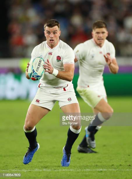 England player George Ford runs at the New Zealand defence as Owen Farrell looks on during the Rugby World Cup 2019 SemiFinal match between England...