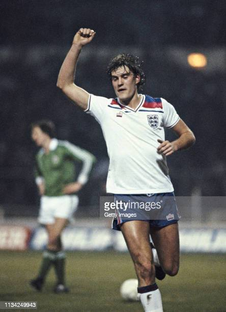 England player Glenn Hoddle celebrates after scoring the 4th goal during the Home International match against Northern Ireland at Wembley Stadium on...