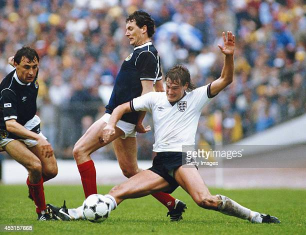England player Glenn Hoddle challenges Jim Bett of Scotland as Maurice Malpas looks on during a Home international match between Scotland and England...