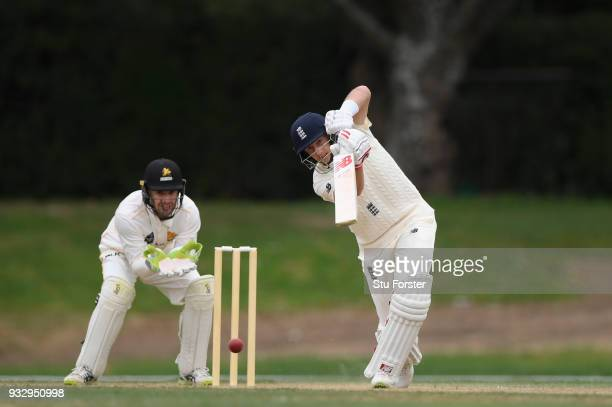 England player Joe Root hits out watched by wicketkeeper Tom Blundell during day two of the Test warm up match between England and New Zealand...
