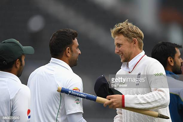 England player Joe Root shakes hands with the Pakistan team after the match during day four of the 2nd Investec Test match between England and...