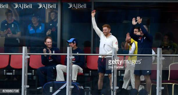 England player Jonathan Bairstow raises the ball after taking a catch off a Moeen Ali six shot on the players balcony during day three of the 4th...