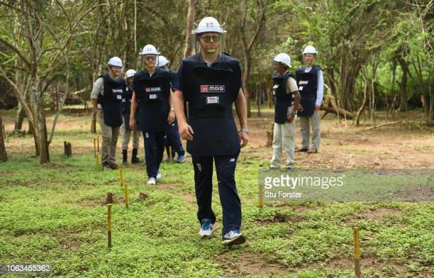 England player Jonny Bairstow and Olly Stone fitted out with de-mining personal protective equipment on a tour of a previously cleared area of mine...