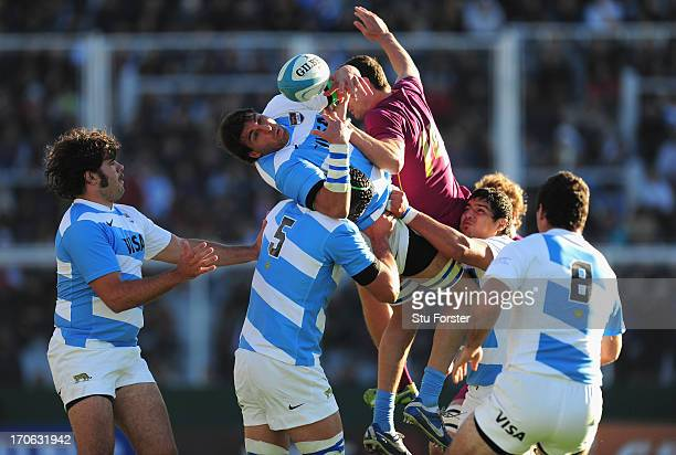 England player Jonny May challenges Argentina forward Esteban Lozada for the ball during the second test match between Argentina and England at the...