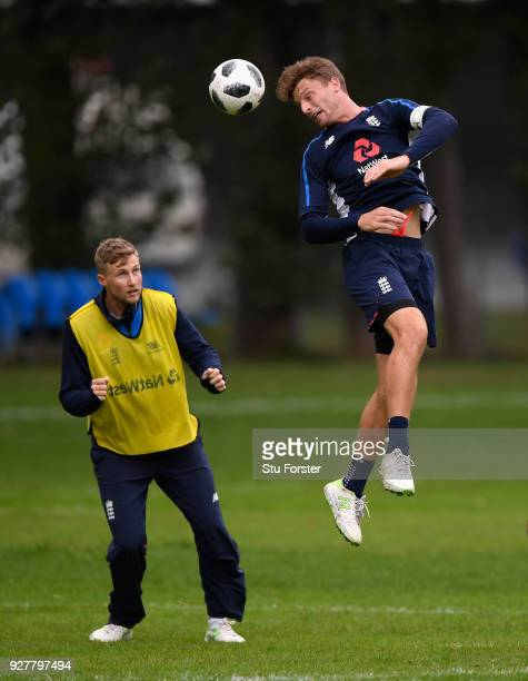 England player Jos Buttler wins a header watched by Joe Root during a game of Football during an England training session ahead of the 4th ODI v New...