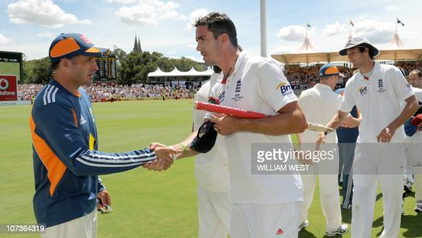 England player Kevin Pietersen shakes hands with Australian player Michael Hussey after England defeated Australia on the final day of the second...