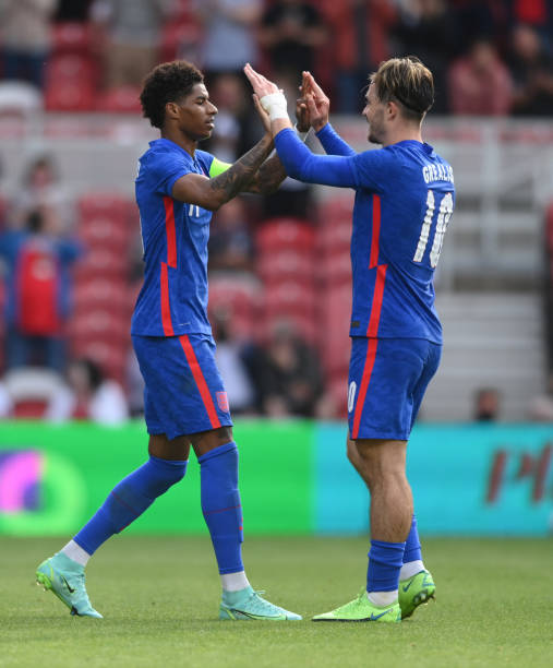 England player Marcus Rashford celebrates his goal with Jack Grealish during the international friendly match between England and Romania at...