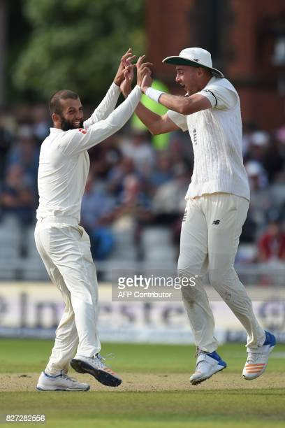 England player Moeen Ali celebrates the dismissal of South Africa's batsman Theunis de Bruyn with Stuart Broad on day 4 of the fourth Test match...
