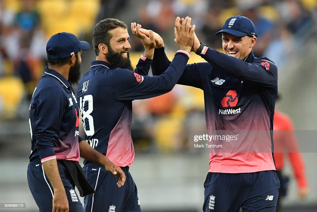 England player Moeen Ali is congratulated for bowling the ball that got New Zealand player Colin de Grandhomme out during game three of the One Day International series between New Zealand and England at Westpac Stadium on March 3, 2018 in Wellington, New Zealand.