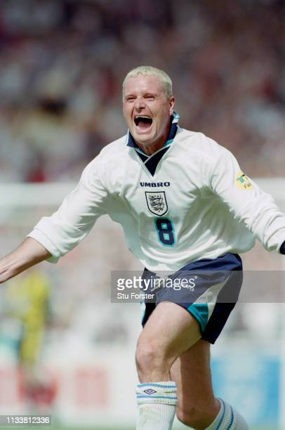 England player Paul Gascoigne celebrates after scoring during the 1996 European Championships Group match against Scotland at Wembley Stadium on June...