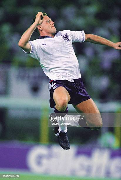England player Paul Gascoigne celebrates after supplying the ball for David Platt to score the winning goal during the 1990 World Cup match between...